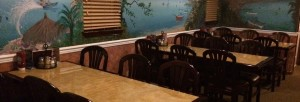 Row of tables inside Nick's Pizza Restaurant