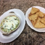 Cheese and spinach dip with side of pita chips