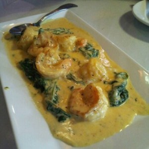 Shrimp covered with cheese sauce and spinach