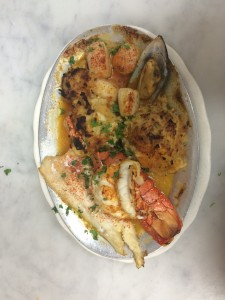 Large seafood platter with salmon, shrimp, oyster and crab