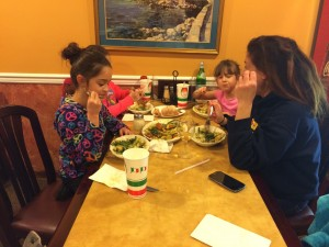 Family eating dinner inside restaurant