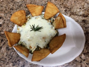 Spinach and cheese dip with pita chips